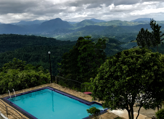 outdoor pool with sunset view club lespri kandy
